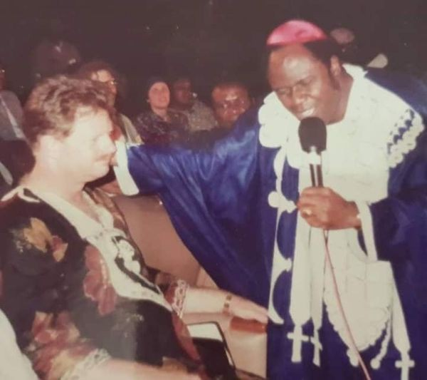 Archbishop Benson Idahosa praying For a man